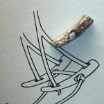 Demirsiz bir dizginin parçası (kemikten)