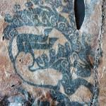 Çeşitli yaratıkların resmedildiği bir erkeğe ait dövmeli sağ kol derisi. / Pazırık Kurganı–2 MÖ. 300-290